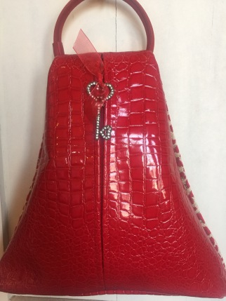 """I created another version called """"Chasing Sunny"""" with a red suede handle  and a zipper pull that adds a bit of bling with a rhinestone key. 241091f743a30"""
